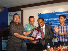 A crest is being handed over to Prof. Dr. SM Mannan by Dr. Mirza Mohd Rezaul Islam